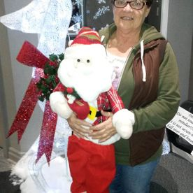 Happy prize winner with Santa Claus